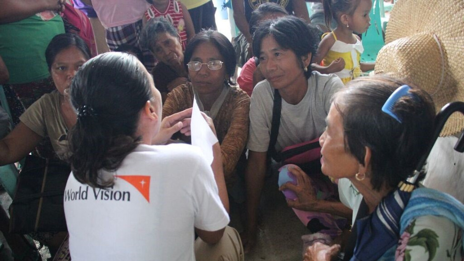 World Vision staff talk with the community on the extent of damage caused by Typhoon Ompong