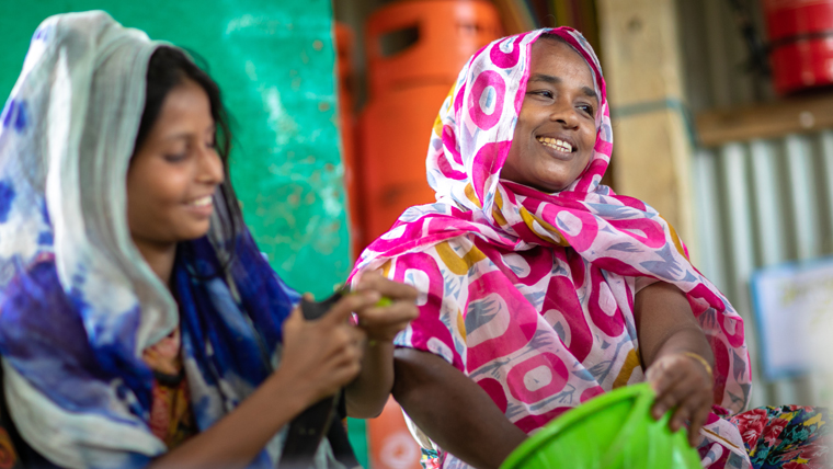 Rohingya women share information and tips, as well as cooking nutritious meals at the community kitchen