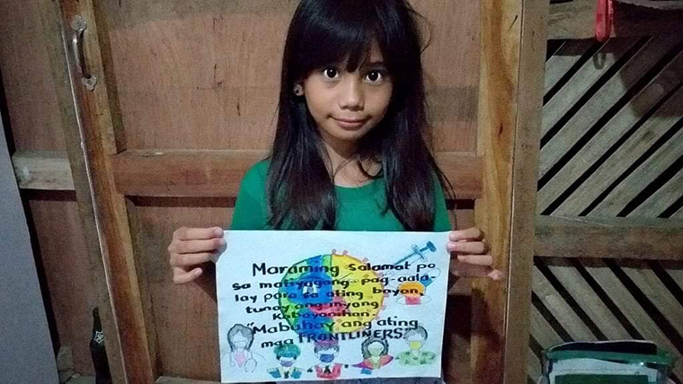 A girl in the Philippines shares a message of hope to frontline workers in the coronavirus crisis