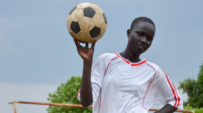 Margaret is a midfielder who plays football with her friends.