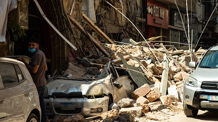 Cars under the rubble of buildings destroyed in Beirut's blast