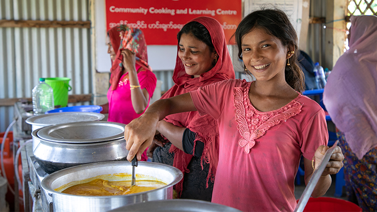 Raju,12, can cook with her mum at the Community Kitchen in their refugee camp in Bangladesh