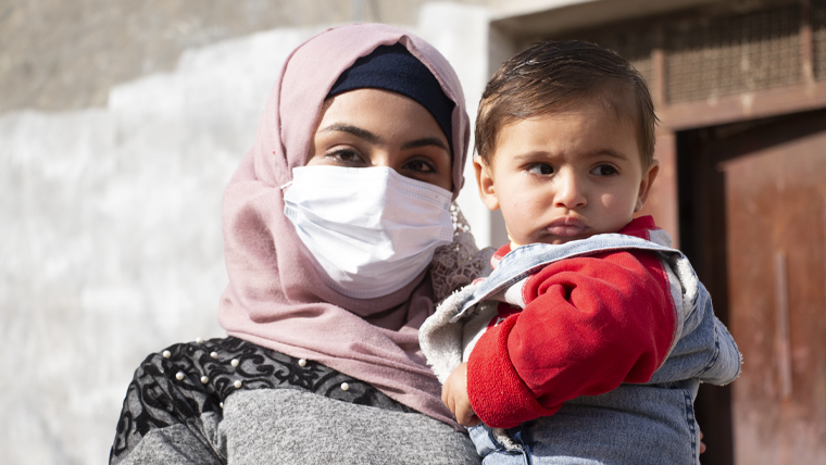 Syrian refugee Fatimah, with her baby son, now living in Jordan