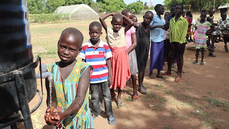 Children in South Sudan line up to wash their hands