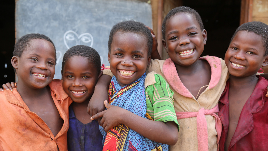 Why sponsor a child - you can help children like these five children smiling together