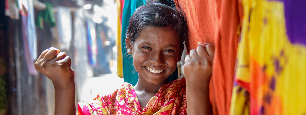 Thirteen-year-old Shyamoli shows what a strong woman looks like to her.