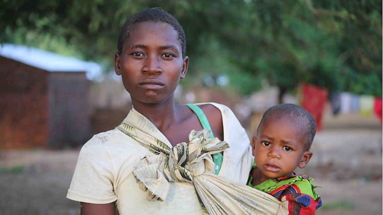 Mother and child amongst the devastation from Cyclone Idai
