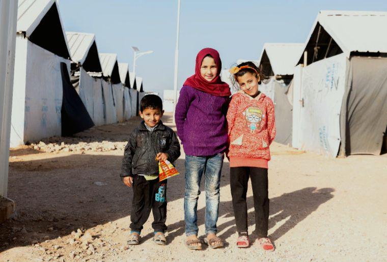 Three children in a World Vision refugee camp in Jordan