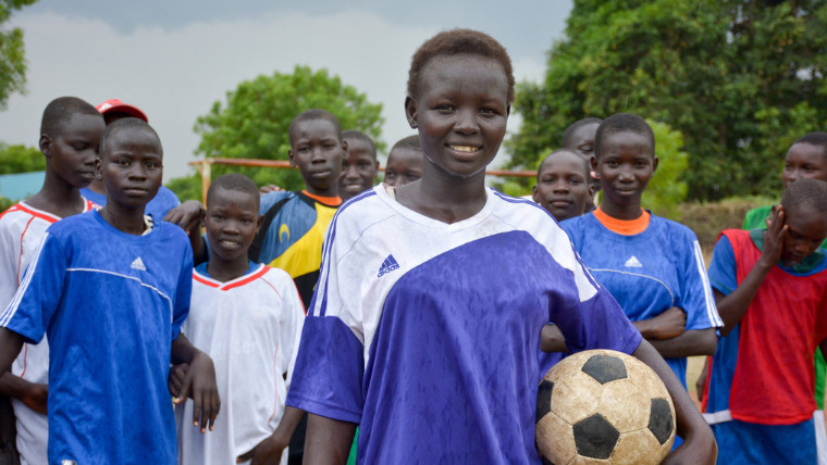 Dina, 18, plays football with her friends in South Sudan.