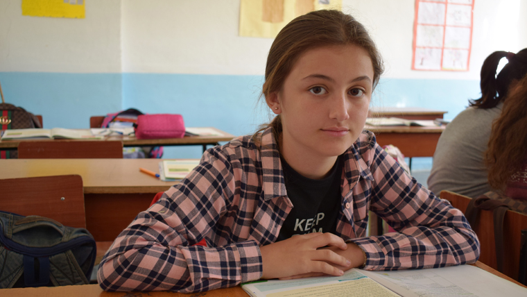 Sheri, 14, at school in Albania