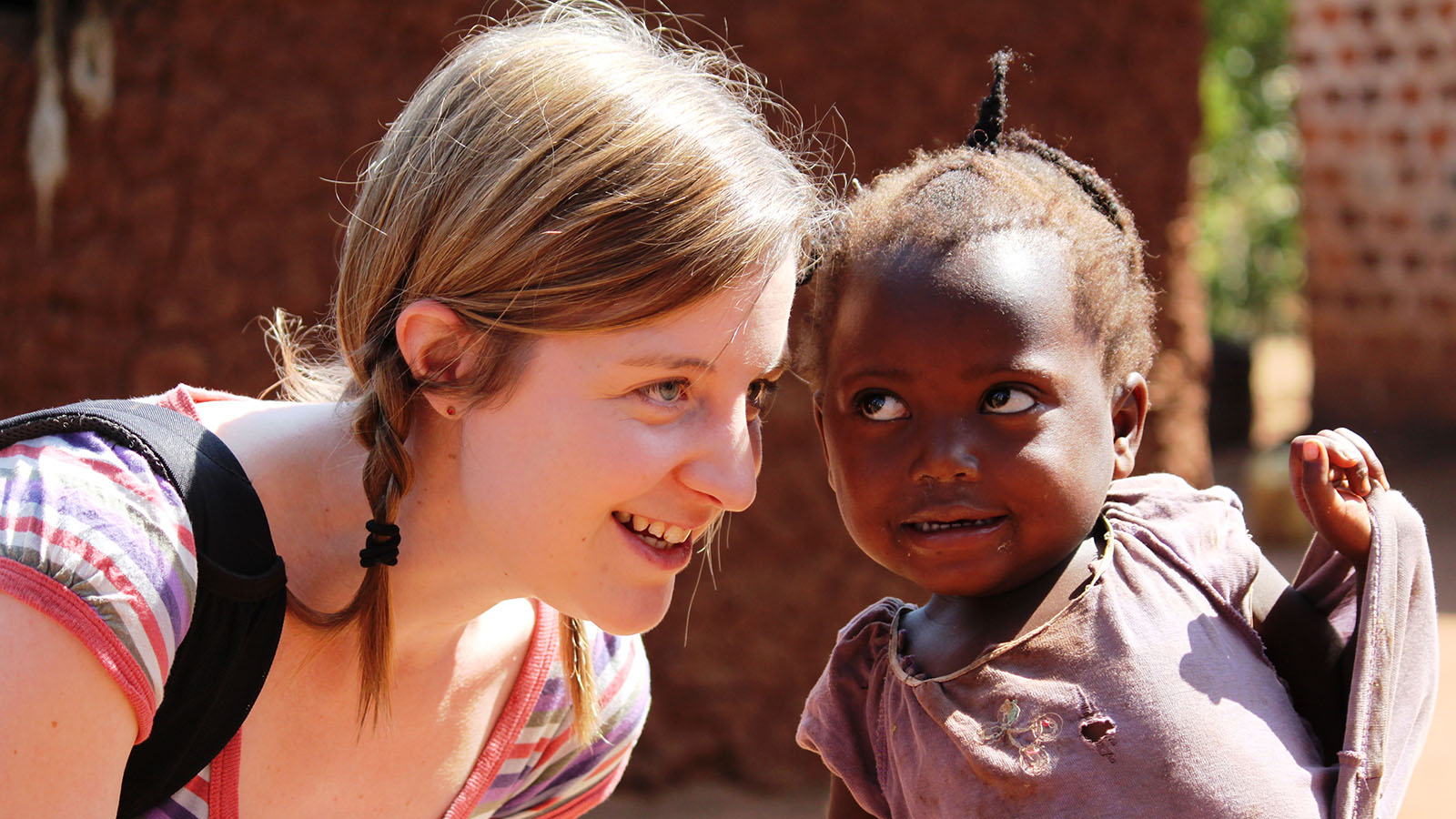 Why sponsor a child - Clare with her sponsored child who play a special part in each other's lives