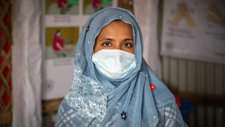 Fatema, wears a protective face mask as she meets with her fellow Rohingya mothers