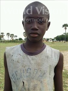 Choose a child to sponsor, like this little boy from Loul, Jean Mbissane age 11
