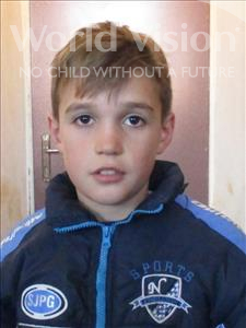 Choose a child to sponsor, like this little boy from Shkodra, Dejvis age 12