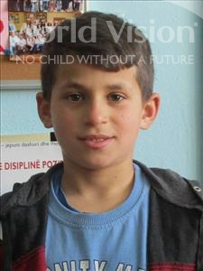Choose a child to sponsor, like this little boy from Shkodra, Aurelian age 12