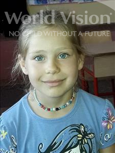 Choose a child to sponsor, like this little girl from Shkodra, Besjana age 7