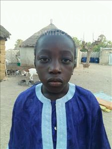 Choose a child to sponsor, like this little boy from Mbella, Serigne Modou age 8