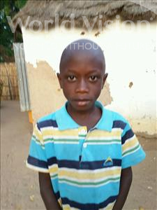 Choose a child to sponsor, like this little boy from Mbella, Amath age 8