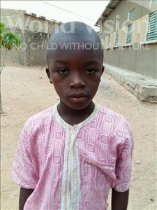 Choose a child to sponsor, like this little boy from Mbella, Samba age 8