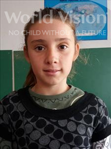 Choose a child to sponsor, like this little girl from Shkodra, Elsida age 13