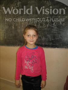 Choose a child to sponsor, like this little girl from Shkodra, Valsona age 7