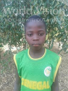 Choose a child to sponsor, like this little boy from Mbella, Gorgui age 12