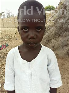 Choose a child to sponsor, like this little boy from Mbella, Aliou age 7