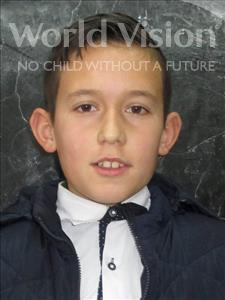Choose a child to sponsor, like this little boy from Shkodra, Andrea age 12
