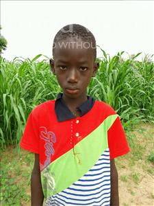 Choose a child to sponsor, like this little boy from Mbella, Aliou age 9