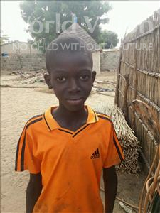 Choose a child to sponsor, like this little boy from Mbella, Pape Mahecor age 9