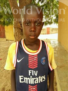 Choose a child to sponsor, like this little boy from Mbella, Khadim age 10