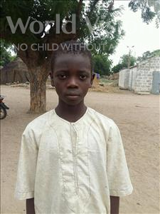 Choose a child to sponsor, like this little boy from Mbella, Ngor age 9