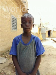 Choose a child to sponsor, like this little boy from Mbella, Niokhor age 9