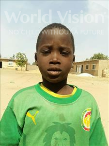 Choose a child to sponsor, like this little boy from Loul, Jean Pierre Diogoye age 7