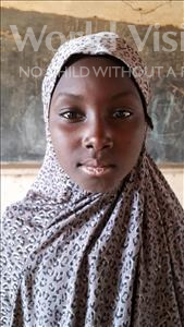 Choose a child to sponsor, like this little girl from Komabangou, Barira age 11
