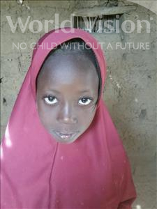 Choose a child to sponsor, like this little girl from Komabangou, Rabi age 8