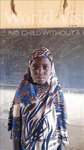 Choose a child to sponsor, like this little girl from Komabangou, Samsia age 7