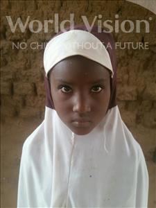 Choose a child to sponsor, like this little girl from Komabangou, Hamsatou age 7