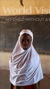 Choose a child to sponsor, like this little girl from Komabangou, Hafissatou age 7
