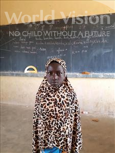 Choose a child to sponsor, like this little girl from Komabangou, Hafsetou age 8