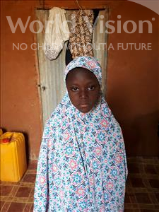 Choose a child to sponsor, like this little girl from Komabangou, Fati age 7
