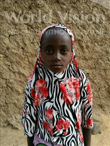 Choose a child to sponsor, like this little girl from Komabangou, Fiddosi age 6