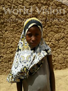 Choose a child to sponsor, like this little girl from Komabangou, Rouhana age 7
