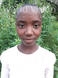 Choose a child to sponsor, like this little girl from Kilimatinde, Ester Yohana age 11
