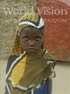 Choose a child to sponsor, like this little girl from Komabangou, Roukkeya age 7